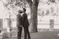 Grooms kissing at their first look at a gay wedding at Epona Estate in Hidden Valley, CA.
