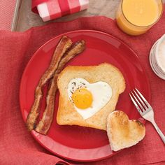 Heart-Shaped Eggs and Toast make a perfect Valentine's Day breakfast. I have the heart shaped cookie cutter, thank you martha stewart