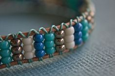 Blue Seed Bead Bracelet by treeleafjewellery on Etsy Mais To make my rainbow bracelet wider - Jewelry Ideas Use thick threads on sides to add color. I've got some silk cord that would work beautifully for the thread. Jewelry Patterns, Bracelet Patterns, Bracelet Designs, Seed Bead Jewelry, Beaded Jewelry, Seed Beads, Jewellery, Fine Jewelry, Cartier Jewelry
