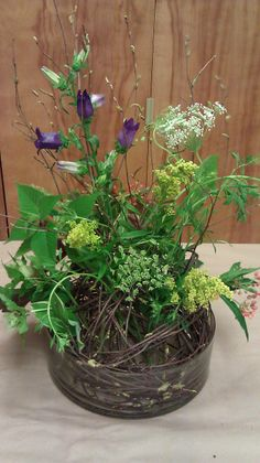 Simple green arrangement from a naturally shaped branch foundation, flowers from Longwood Gardens!