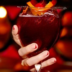 A subtle stripe of minimalist nail art matches perfectly with this glass of sangria.