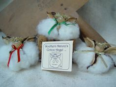Original Cotton Angel, Christmas (tm) Group of 3 Adorable Cotton Boll Angels with Christmas bows... $18.50, via Etsy.