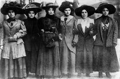 Six women including Mary Dreier, Ida Rauh, Helen Marot, Rena Borky, Yetta Raff, and Mary Effers  linked arm in arm in their march to City Hall during the shirtwaist strike to demand an end to abuse by police . Other shirtwaist strikers follow behind carry by Kheel Center, Cornell University, via Flickr