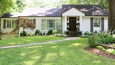 House and trim- Benjamin Moore: China White. Fence and shutters- Benjamin Moore: Kendall Charcoal. House Paint Exterior, Exterior Paint Colors, Paint Colors For Home, Exterior Design, Castle Painting, House Painting, Gutter Colors, Painted Brick Exteriors, Hart House