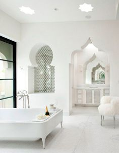 1001 night bathroom - This bathroom is pure fusion. The freestanding bath faucet, the black framed glass door and the molded bathtub are western luxury, while the window and door cuts are classic Arabic style.