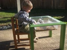 DIY sensory table from a thrift store table and plastic bin! Love this!