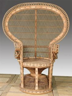 WICKER FAN BACK GARDEN CHAIR  I used to have a chair like this in my first apartment . hmmmmmmm?