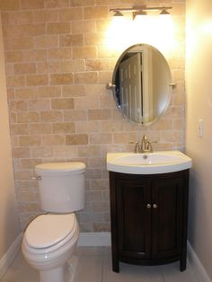 Powder Room Update on a Shoestring Budget, We started by creating an accent wall with a subway travertine tile. We were looking for a round...