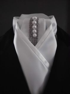 Dressage stock tie by Equestrian Pzazz. Delustered satin, silver braid and faux pearls. Check out our page for more stunning designs! www.facebook.com/eqpzazz #dressage #horses #equestrianstyle #dressagequeen