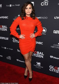 Heart's afire: The singer stunned in a clingy red dress while hitting up the red carpet at...