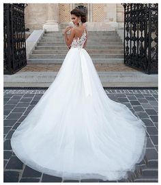 Visit us for more information & reviews. www.BlissGown.com Train: Sweep/ Brush Train Wedding Dress Fabric: Tulle Neckline: Scoop Dresses Length: Floor-Length For Pregnant Women: Yes Sleeve Length(cm): Sleeveless Back Design: Backless Decoration: Appliques Decoration: Lace Decoration: Ribbons Decoration: Button Item Type: Wedding Dresses Fashion Element: Illusion Built-in Bra: Yes Waistline: Natural Silhouette: A-Line is_customized: Yes Sleeve Style: REGULAR Lace Wedding Dress, 2016 Wedding Dresses, Bridal Dresses, Wedding Gowns, Dresses 2016, Tulle Wedding, Gowns 2017, Elegant Wedding, 2017 Wedding