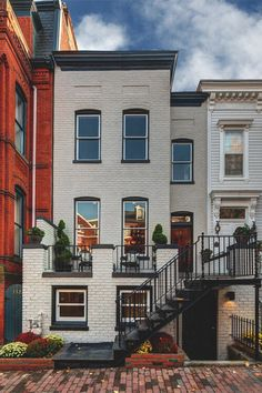 Painted brick townhouse.