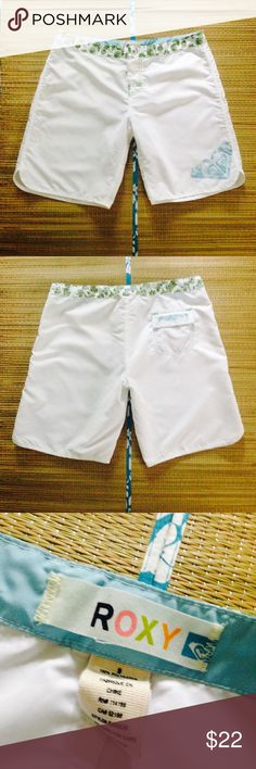 White Roxy Bermuda Shorts White Bermuda Shorts from Roxy featuring logo design on the left leg. Purchased from Club Med Punta Cana & worn once. Soft fabric w/ velcro & button front closure. Green floral print around waist. Flat panel pocket with velcro flap closure on back right leg. In great like new condition. 100% Polyester. Perfect for a day at the beach or pool.  Shine bright.     No Trading   Bundling Available  Fast Shipping    Holds for over $50 for 24 hrs only  Top 10% Sharer…