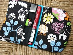 Fabric pouch for tobacco with 3 compartments.