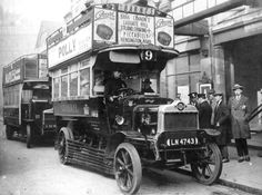 From the Hammersmith gazette archives, the no 9 bus is holding up traffic as two guys in suits and caps are the first people to be arrested for fare evasion.