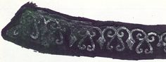 A photo of extant Viking era embroidery from the book Viking Artefaks.