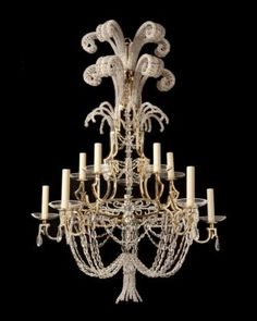 "Marvin Alexander,Inc. ""BAGUES"" gilt bronze and crystal twelve light two tiered chandelier, France circa 1930."