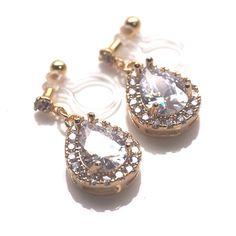 Sparkly bridal cubic zirconia invisible clip on earrings.  🌺Gorgeous cubic zirconia teardrop earrings are available now. Ideal for weddings and elegant occasions. They seem heavy since crystals are filled but they are only 3 g, lightweight! Comfortable!
