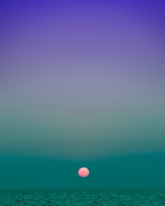 Minimalist Landscapes of the Setting and Rising Sun Shot Against Pristine Skies