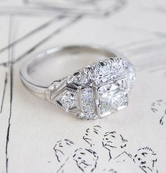 1920's Tiered 1.14 carat Diamond and Platinum Engagment Ring  www.EricaWeiner.com My FAVORITE jeweler. All estate pieces and/or antiques turned into jewelery.