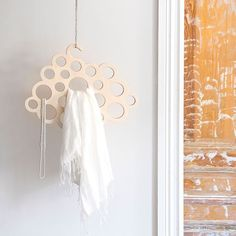 Cloud is a hanger storage for accessories such as ties, belts, tights, socks, jewelry and all the other accessories that tend to get lost in drawers and wardrobes. It fits perfectly in the closet, but can also be hanged on a wall from the ceiling for display. Available in birch plywood and white wood.