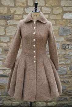 that's great knitting..    ( Hand-knitted Holst Coat £1,600.00 )