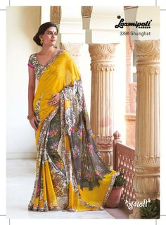 Cart wheel and floral prints on mustard georgette saree are flavor of craft.