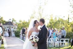 Purple, green, white and silver wedding at Carmel Mountain Ranch Country Club in San Diego, California. #brideandgroom #couple #ceremony #kiss