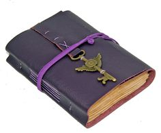 Purple Leather Journal with Tea Stained Pages. $36.00, via Etsy.
