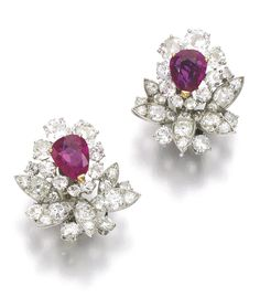 Pair of ruby and diamond ear clips, Monture Mauboussin, 1960s. Each of cluster and foliate design, set with pear-shaped rubies, circular, single-cut and cushion-shaped diamonds. Sotheby's.