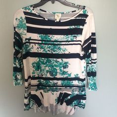 Beautiful top from anthropologie Size small. Three quarter length sleeves. Navy, white, and a green/turquoise print. Tiny spot on front as pictured Anthropologie Tops