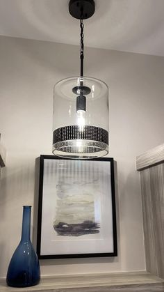 Glass Meets Metal In This Versatile 1-Light Pendant Featuring A Perforated Band In Matte Black Accentuated By Decorative Rivets. Try A Trio Over The Island, A Pair Flanking The Bed Or Add Pop To An Overlooked Space Such As The Laundry Room Or Closet With A Single Pendant. #kitchenislandpendants #pendants #Laundryroomlighting #laundryroomlights #laundryroomlightingfixture #Laundryroomideas #pendantsoverkitchenisland #kitchenligting #kitchenlightingfixtures #kitchenlightingoverisland Laundry Room Lighting, Kitchen Lighting Fixtures, Light Pendant, Pendant Lighting, Matte Black, Home Kitchens, Entrance, Ceiling Lights, Simple