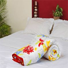 Abstract floral prints of golden yellow lilies, red, yellow and blue dahlias are painted on this white backdrop. Rs 1569/- http://www.tajonline.com/gifts-to-india/gifts-AR5670.html?Aff=pint2014/