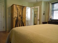 Edith Wharton room at the 1900 Inn on Montford. Armoire houses a HDTV and DVD Player.
