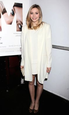 Photos via: Lizzie-Olsen Elizabeth attends a movie event in a bright classic white look with...
