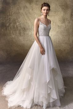 A-line wedding dress idea - beaded Venise lace and spaghetti straps with stones on bodysuit with V-neckline, V-back with crystal buttons over invisible zipper. Detachable, tiered tulle and chiffon skirt with thin beaded belt. Style Leighton Bodysuit & Leann Skirt by @enzoani.