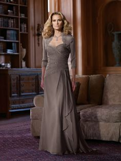 Two-piece two-toned chiffon dress set, strapless sweetheart A-line dress with pleated hand-beaded bodice with lace trim, asymmetrically dropped waistline, mock wrap skirt with cascading ruffle, matching bolero jacket with three-quarter length sleeves and beaded trim. Removable straps included. Sizes: 4 � 20