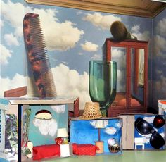 An Art lesson on Renee Magritte, a surrealist painter. We made miniature surrealistic bedrooms with cardboard boxes, fabric, fake fruit, etc.