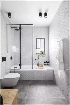 Small Bathroom Renovations 726416614876779373 - Simple modern bathroom with white subway tile herringbone on walls and tub. Modern Bathroom Design, Bathroom Interior Design, Decor Interior Design, Bathroom Designs, Modern Bathrooms, Dream Bathrooms, Minimalist Small Bathrooms, Modern Bathtub, Farmhouse Bathrooms
