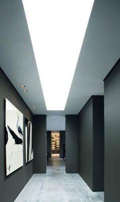 Corridor with Black and White Art Corridor Lighting, Interior Lighting, Lighting Design, Artwork Lighting, Dark Interiors, Office Interiors, Architecture Details, Interior Architecture, Modern Interior