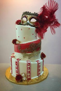 CAKE OF THE DAY!! Ivory and red Mascarade ball topsy turvy sweet 16 cake! Elegant and funky!   Like it, Love it, Share it! www.facebook.com/ChocaL8kiss Instagram @ChocaL8kiss Bakery Bakery Bakery Bakery https://pinterest.com/chocal8kiss/  1-888-YUM-CAKE 986-2253 285 Gordons Corner RD Manalapan NJ