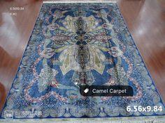 a unique blue hand knotted silk rug info@camelcarpet.com