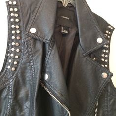 Forever 21 faux leather vest with metal detailing Lightly worn faux leather vest with stud and zipper details from forever 21. Very cute for layering in the fall! Forever 21 Jackets & Coats Vests
