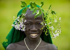 Eric Lafforgue  www.ericlafforgue.com Surma kid with flowers - Tulgit Ethiopia