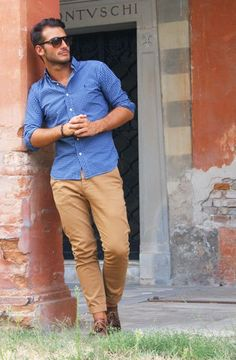 Shop this look on Lookastic:  https://lookastic.com/men/looks/dress-shirt-chinos-derby-shoes-sunglasses-bracelet/12827  — Dark Brown Sunglasses  — Blue Gingham Dress Shirt  — Dark Brown Bracelet  — Khaki Chinos  — Brown Leather Derby Shoes