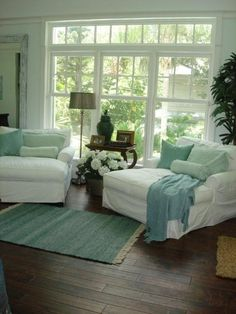 cozy:) my kind of living room..love the dark floors with the light furniture and white walls..love the blues/sea green type colors...pretty much like my living room
