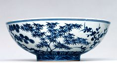 Bowl  China, Jiangxi Province; Ming period (1368-1644), Xuande era, 1426 - 1435  The imagery painted on the side of this large, shallow bowl is an example of the themes that reflect the interests of the scholar-gentleman class. Because pine, plum, and bamboo, the elements that make up the decoration of this bowl, flourish even under adverse conditions, they are grouped together as the Three Friends of Winter, symbols of the upstanding character of a scholar-gentleman when faced with hardship.