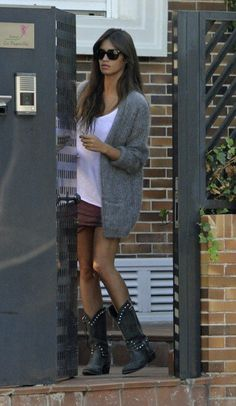 Sara Carbonero in white t-shirt, burgundy mini-skirt, black Ash boots, and grey H&M cardigan.
