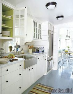 I love the inside of cabinets painted for a pop of color!