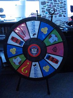 Let Freedom Spin! The prize wheel - it's real! And it makes the noises exactly as heard on the podcasts! (http://PrizeWheel.com/products/tabletop-prize-wheels/tabletop-black-clicker-prize-wheel-12-slot/)
